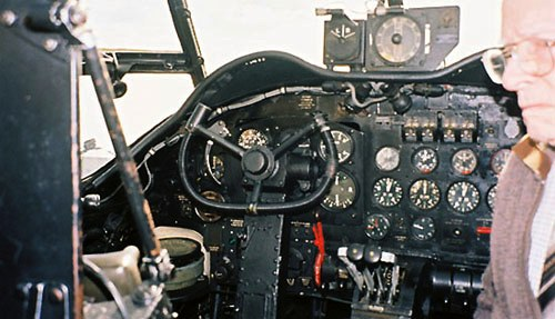Lancaster - Dad in cockpit from navigators position.jpg