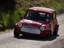 10515488-loughrea--august-28-lloyd-hutchinson-driving-a-red-austin-mini-cooper-s-car-30-when-loosing-its-whee.jpg